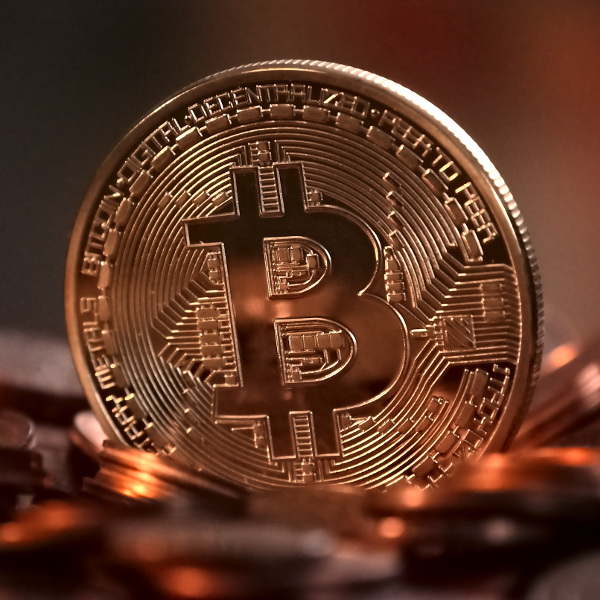 Bitcoin lower as virtual currency splits in two in 'hard fork'